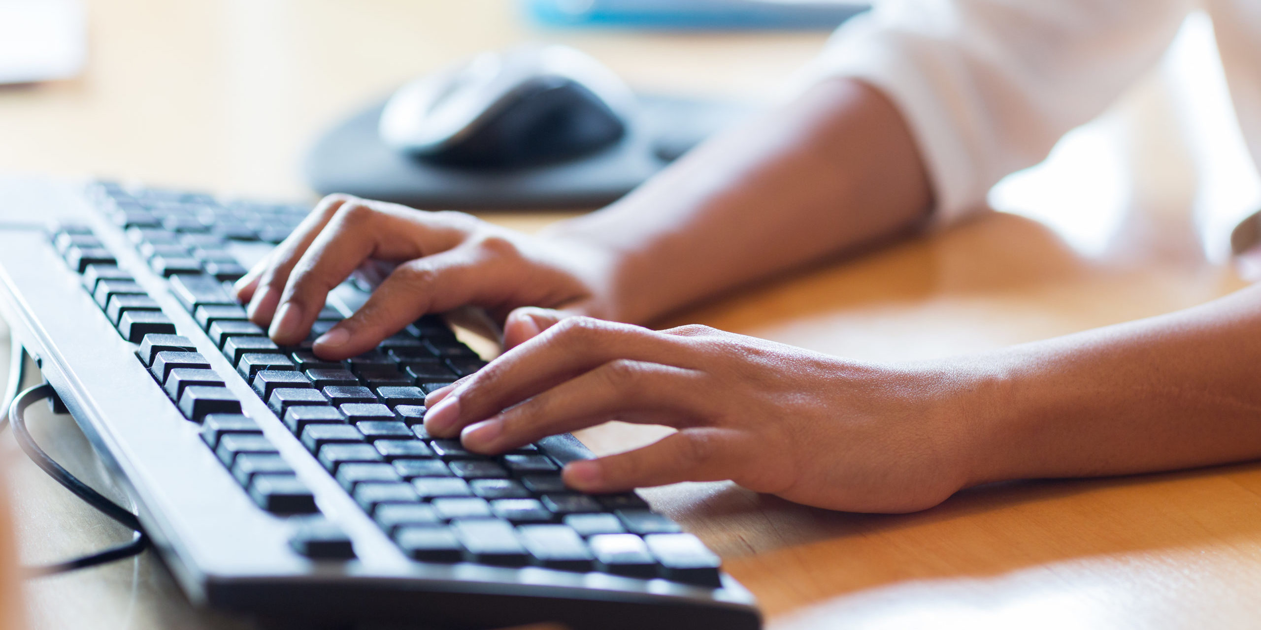 business, education, programming, people and technology concept - close up of african american female hands typing on keyboard